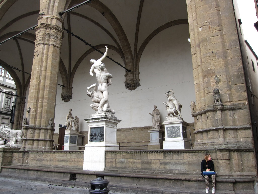 A young artist getting inspiration from the Loggia dei Lanzi outdoor sculpture gallery.
